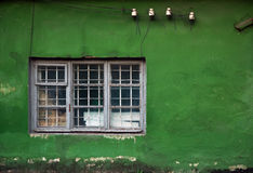 Old damaged windows, grunge window, green wall texture Royalty Free Stock Photo