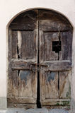 Old damaged wooden locked door Royalty Free Stock Photography