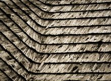 Old damaged wooden shingle roof Stock Photos