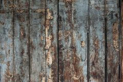 Old damaged wooden wall or fence aged and Stock Photo