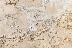 Old damaged yellow concrete wall texture Stock Photos