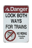 Old danger traffic sign. Look both ways for trains on white background Stock Images