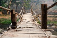 Old and Dangerous Tribal Bamboo Bridge Cross Over the River. Local Area in Thailand royalty free stock photos