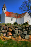 Old Danish Church. Old whitewashed Danish Church with red tiled roof and small bell tower Stock Images