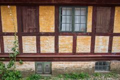 Traditional timbered danish house. Old Danish timbered house facade with beautiful garden, Aarhus, Denmark, September 2017, Den Gamle By Stock Photos