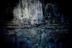 Old dark blue wall background. Rustic texture plaster with lots of cracks and scratches. Royalty Free Stock Photography