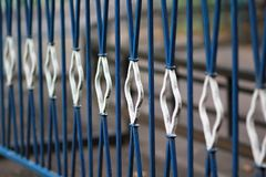 Old dark blue and white metal wrought fence, diminishing perspective Stock Images