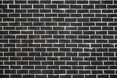 Old dark brick wall texture or background.  Stock Photo