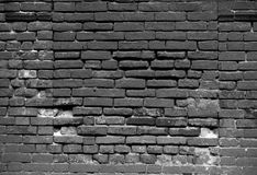 Old dark brick wall, texture background. Wintage gray wall.  Stock Photos