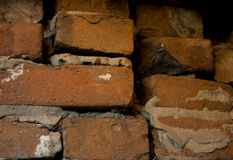Old dark brown and red brick wall with cement slurry background, old brickwork Royalty Free Stock Image