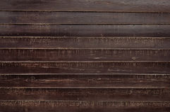 Old dark brown wooden fence background texture Royalty Free Stock Image