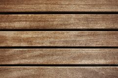 Old dark brown wooden fence background texture. Close up Stock Photography