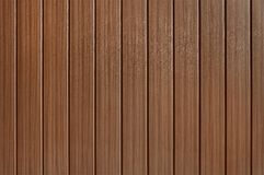 Old dark brown wooden fence background texture. Close up Royalty Free Stock Photo