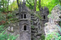 Old dark castle in the green forest. Small old dark castle in the green forest stock images