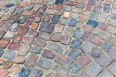 Old dark colorful cobblestone road Stock Images
