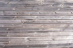 Old dark and damaged with black fungus wooden texture of planked wall closeup view royalty free stock photo