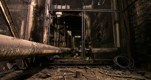 Old dark decaying dirty factory. Old creepy dark decaying dirty factory royalty free stock photos