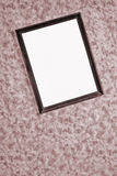 Old dark frame/mirror. On the wall royalty free stock images