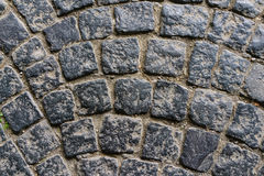 Old dark granite stone floor pattern as background in Italy Royalty Free Stock Photography