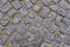 Old dark granite stone floor pattern as background in Italy Royalty Free Stock Photos