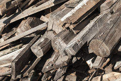 Old dark gray wooden boards, ruined rural house Stock Photos