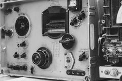 Old dark green amateur ham radio. On wooden table stock images