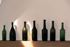 Old dark green Normandy cider and calvados bottles Stock Photo