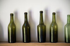 Old dark green Normandy cider and calvados bottles Royalty Free Stock Images