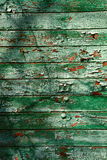 Old dark green wall from wooden planks with paint traces Stock Photos