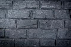 Old dark grey brick wall. Background, horizontal Stock Photos
