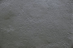 Old dark grey concrete wall background texture. Close up Royalty Free Stock Images