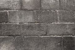 Old dark grey stone wall background texture. Close up Royalty Free Stock Photo