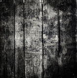 Old  dark  grunge wood background with knots and scratches. Wood Stock Image