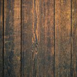 Old dark mahogany wood wall background square format. Old dark mahogany wood wall background square Royalty Free Stock Photos