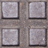 Old dark metal manhole texture with square pattern, background macro, selective focus Stock Photos