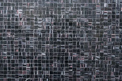 Old dark mosaic tile wall background. Texture close up Royalty Free Stock Photos