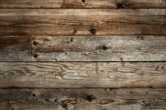 Old dark stained wood background texture. Old dark stained wood background Royalty Free Stock Images