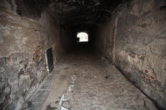 Old dark stone gateway perspective Royalty Free Stock Image