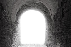 Old dark tunnel corridor with arch opening Light at the end of t Royalty Free Stock Photos