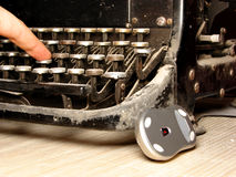 Old dark typewriter with modern mouse Stock Photography