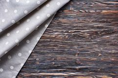Old dark wooden background. Wooden table with grey kitchen towel stock image