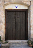 Old dark wooden door. Old door in cyprus village stock image