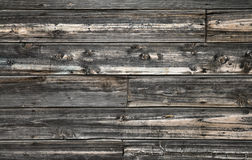 Old dark wooden wall texture. Vintage wooden wall texture with siding, nails and knots Royalty Free Stock Photography