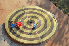 Old dartboard and dart Royalty Free Stock Photos