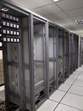 Old data Center racks lineup. With left behind cables Stock Photography