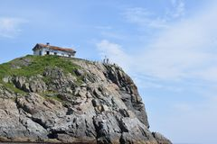 Old day on the mountain. abandoned house on the rocks. Old day on the mountain. abandoned old house on rocks with green grass against blue sky on Sunny summer royalty free stock photos