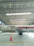 Old DC-9 Aircraft from Right Side Cropped in Hangar Royalty Free Stock Photo