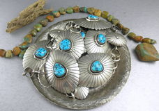 Old Dead Pawn Native American Southwestern turquoise Concho Belt on silver disht Stock Images