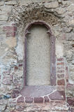 Old dead window. Bricked up window in the side of the old church Stock Photo