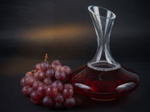 Old Decanter of Red Wine with Grapes Stock Photography